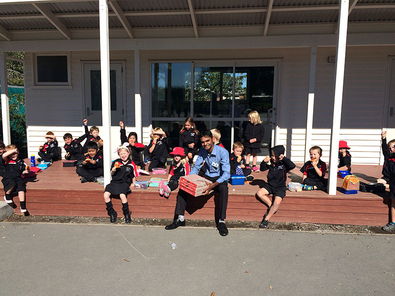 Pizza definitely put smiles on Room 3 pupils at Methven School who won the CrestClean Cleanest Classroom competition. They are pictured with franchisee Mayank Patel.