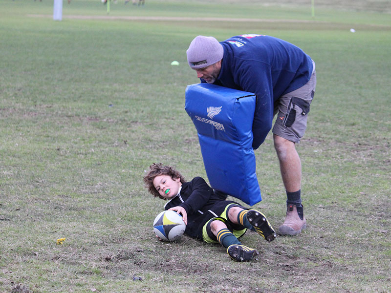 Junior rugby players and coaches practiced a number of skills and drills throughout the coaching session.