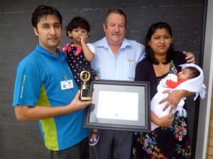 Ashneer and family being presented with his certificate and trophy from Invercargill Regional Manager Glenn Cockroft