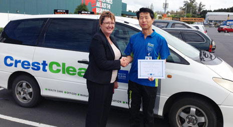 CrestClean Auckland North Shore Regional Manager Caroline Wedding presenting Martin with his 10 year certificate
