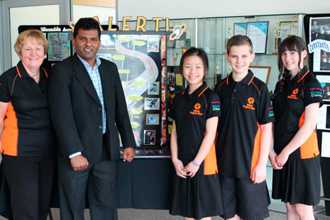 From left: Joan Middlemiss (Principal of Mission Heights Junior College) and Viky Narayan (CrestClean Auckland South and Auckland East Regional Director) celebrate Crest's sponsorship of the Future Problem Solving team of Cailey Dayu, Dylan Townsend, and Courtney Powell.