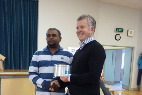 Rajesh Mani receiving his Ten Year Long Service Award from Managing Director Grant McLauchlan at Auckland's Team Meeting on 28 June.