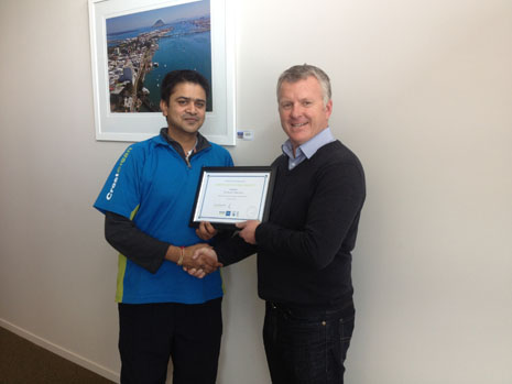 Avikash Sharma receiving his 3 Year Certificate from Grant McLauchlan.