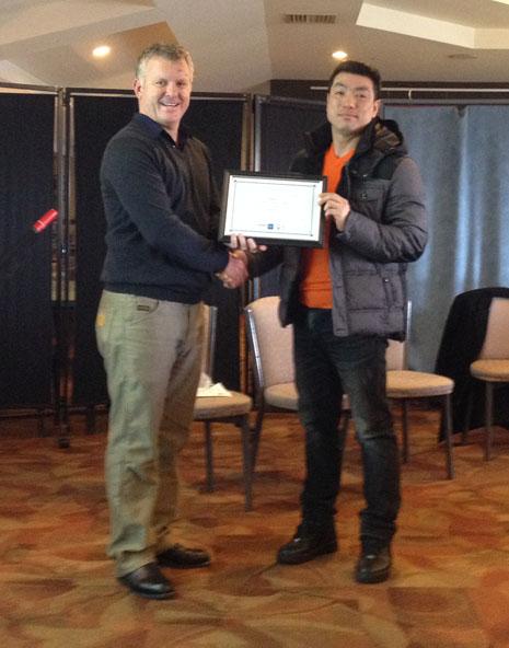 Michael Choi presented with his 5 Years Long Service Award from Grant McLauchlan.