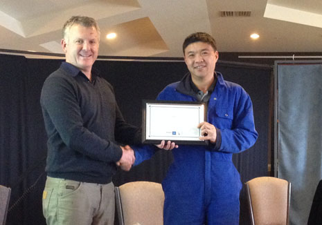 Grant McLauchlan congratulating Tianlei Fu on 5 years with CrestClean.