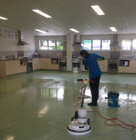 CrestClean franchisee Anuragni Chandra applying stripper during a Hard Floor Care Training Course.