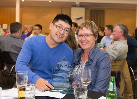 Leo Wang and Caroline Wedding celebrating his award.