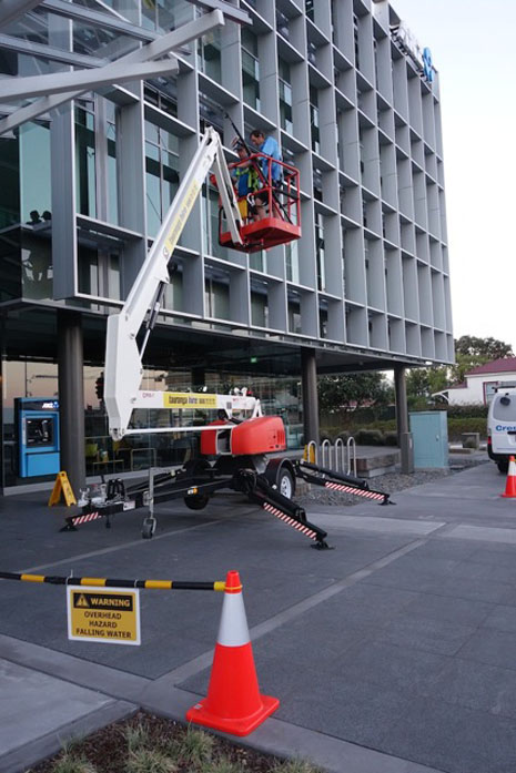 Health and Safety cones, barricades and specific hazard notices are moved along the building as the job progresses.
