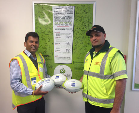 Regional Director for South and East Auckland, Viky Narayan, donating CrestClean rugby balls to Countdown's Quiz Night charity fundraiser.