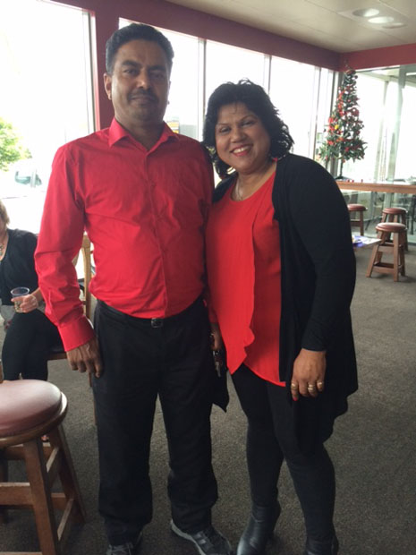 Birendra and Lakshmi Kumar looking festive in matching red.