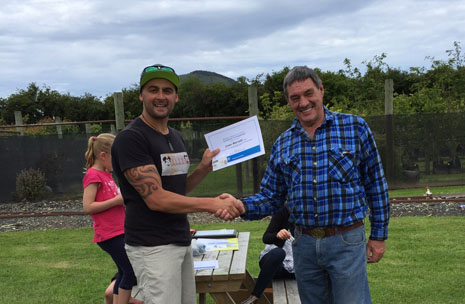 Dunedin franchisee Leon Harrald receiving a training certificate of completion from Regional Director Tony Kramers.