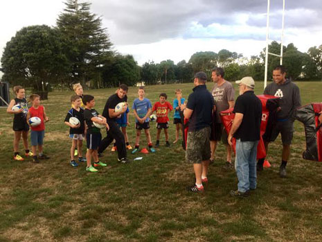 John and the kids demonstrating a skill while Onewhero coaches watch and learn.
