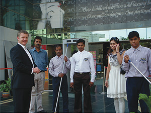 Grant McLauchlan with CrestClean India personnel.
