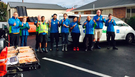 CrestClean Dunedin franchisees enjoyed pizza after they finished cleaning up the kitchen at Radius Fulton Resthome, which was evacuated as a result of flooding.