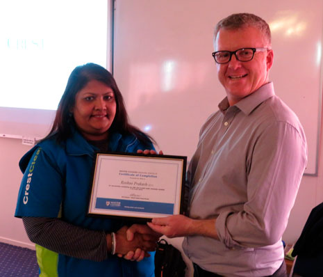 Managing Director Grant McLauchlan presented Roshni Prakash with Master Cleaners Training Institute Module 2 completion certificate.
