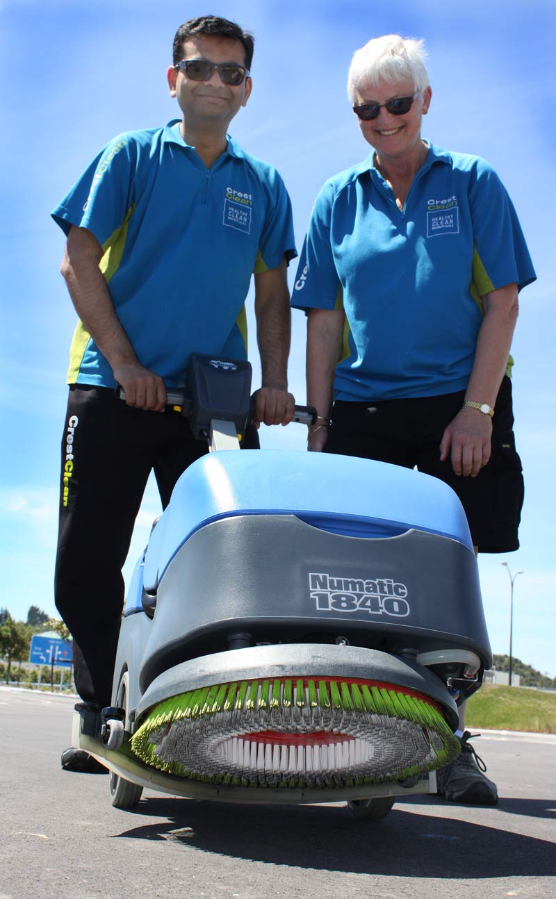 Pinakin Patel and Jill Shepherd check out a battery-powered floor scrubber.