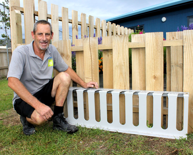 Mike installed a scooter rack at St Thomas More Catholic School, just one of the things he's taken in his stride as caretaker.