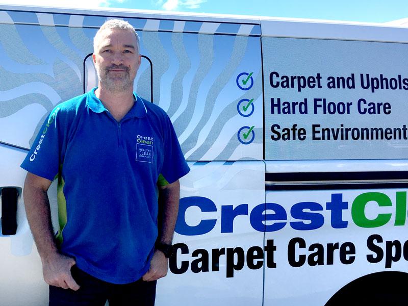 Carpet care expert Kent Wilkinson with his sign-written Nissan NV350 van.
