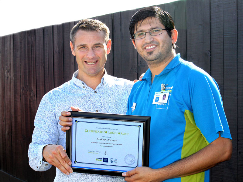 Mukesh Kumar receives his Certificate of Long Service from Jan Lichtwark, CrestClean's Tauranga Regional Manager.