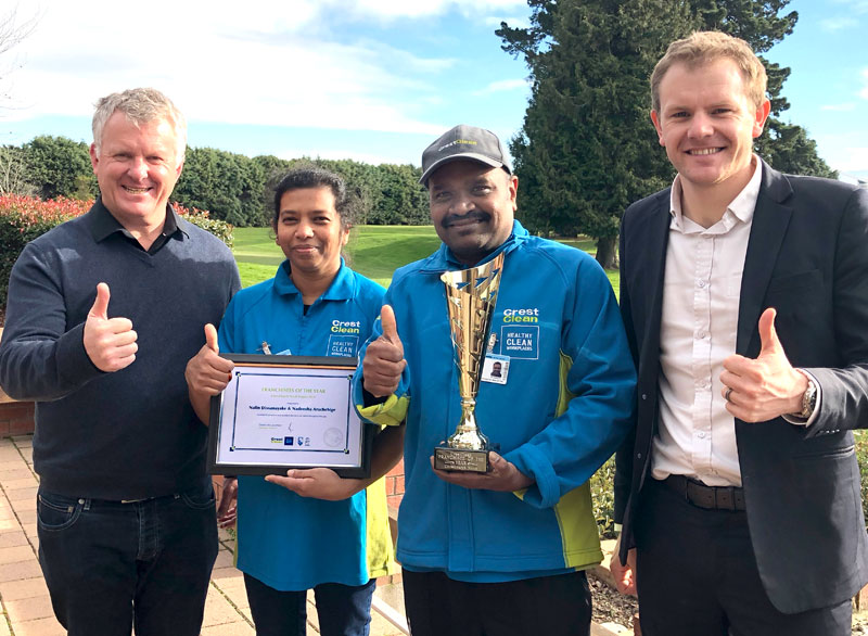 Nadeesha and Nalin Dissanayake receive their award from Grant McLauchlan, Crest's Managing Director, and Sam Lewis, General Manager Franchise Services.