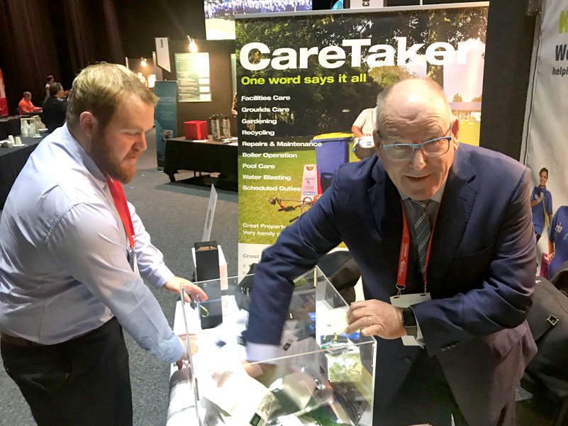 Paul Ferris, CEO of the Catholic Education Convention makes the prize draw on the CrestClean stand. Looking on is Sam Creasy, CrestClean's National Accounts Manager.