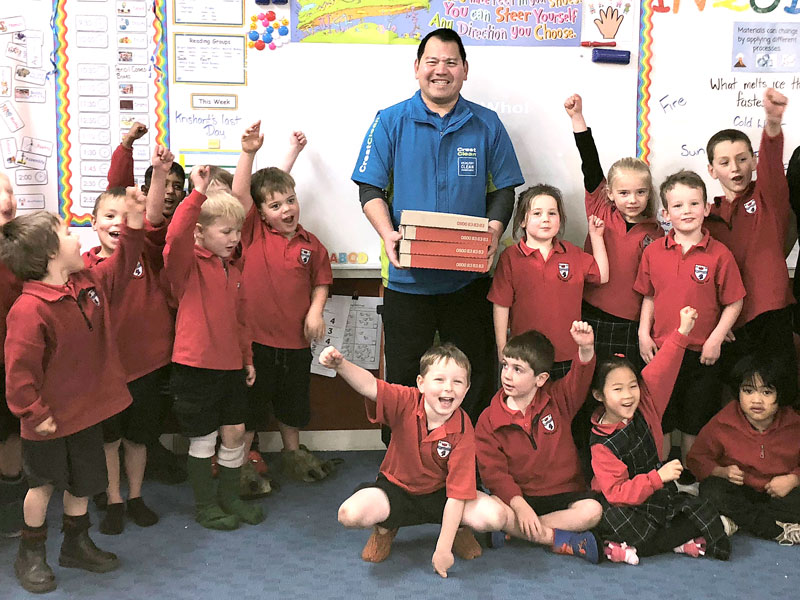 Room 2 (Master Guard Room) at Ashburton Borough School were the lucky winners of Crest's Cleanest Classroom Award. Handing out the pizza is CrestClean business owner Cicero Calzada.