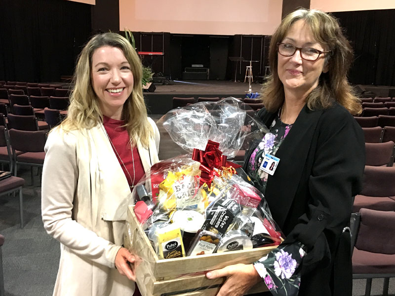 Shona Cawley (left) receives the hamper from Linda Hill.