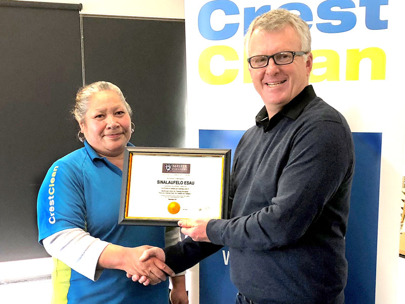 Sina Esau receives a Certificate in Commercial Cleaning Level 2 from Grant McLauchlan, Crest's Managing Director.